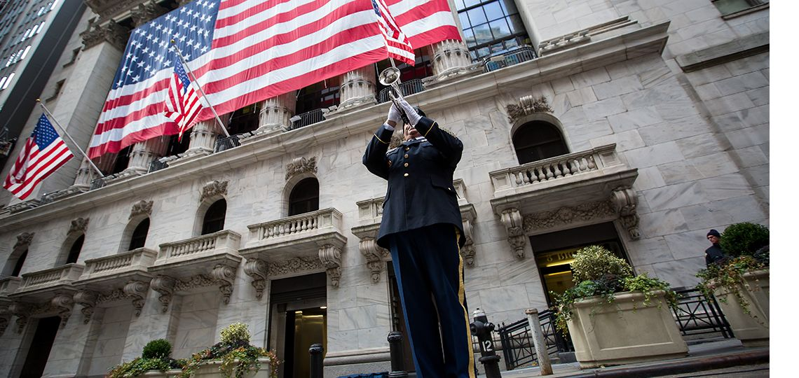 A member of the National Guard plays a trumpet during a flag rai